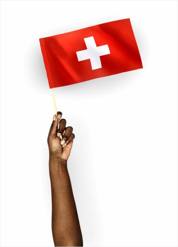 persoon de vlag van zwitserland zwaaien wtwop